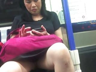 voyeur upskirt of older japanese on commuter