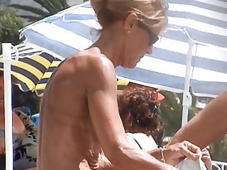 incredible french blond mummy puffy topless beach