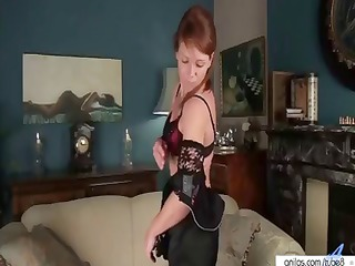 red-haired lass undresses down to her stockings