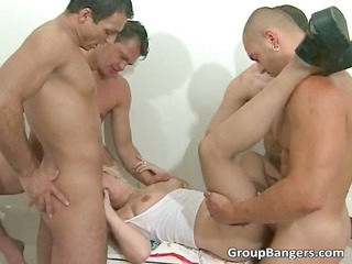 golden-haired honey enjoys in sexy gang bang