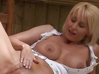 nasty blond momma with big bosom in white suit