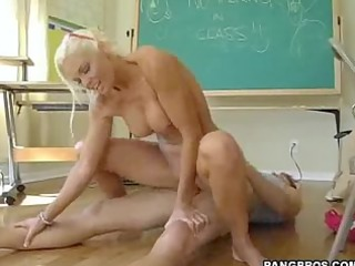 rhylee rides her phys ed teacher in the classroom