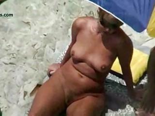 stripped beach mature voyeur 9some