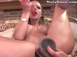 horny golden-haired squirts cum in a glass bowl