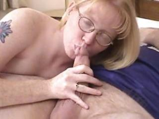 golden-haired milf wearing glasses blows and