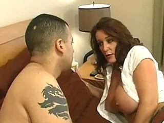 Mature slut with big tits gets a bedroom milf