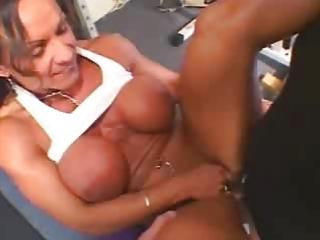 hot older breasty brunette hair bodybuilder