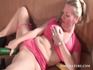 bawdy aged bonks pussy with a cucumber