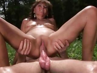 granny enjoys hot sex with boy outdoor