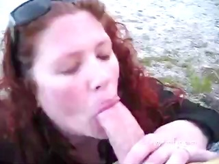 sexy redhead takes his weenie in her throat and