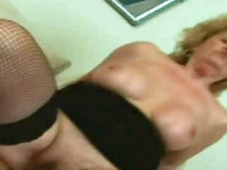 blond granny engulfing and fucking a cock in