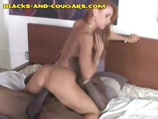 hot redheaded cougar rides his large black
