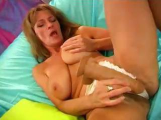 busty blonde mama with a bushy pussy is using a