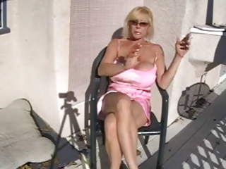 sexy breasty granny smoking and relaxing