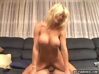 a sexy big tit blonde milf is riding a large hard